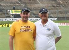 Coach_Devries_(UMN)_and_Miguel